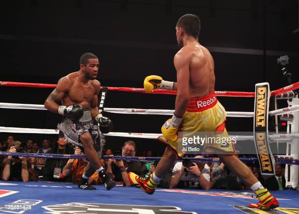Amir Khan backpetals as Lamont Peterson gives chase during their WBA Super Lightweight and IBF Junior Welterweight title fight at Washington...