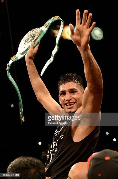 Amir Khan celebrates after his 12th Round unanimous decision against Devon Alexander during their welterweight bout at the MGM Grand Garden Arena on...