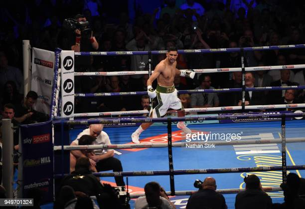 Amir Khan celebrates as he beats Phil Lo Greco during their welterweight bout title fight at Echo Arena on April 21 2018 in Liverpool England