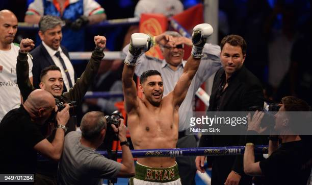 Amir Khan celebrates as he beats Phil Lo Greco during their welterweight title fight at Echo Arena on April 21 2018 in Liverpool England