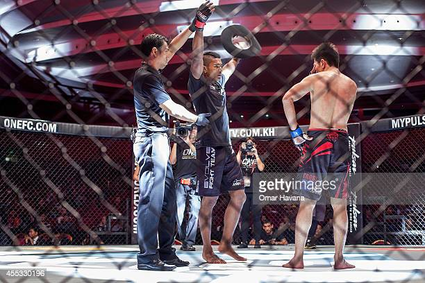 Amir Khan celebrates his victory against Jian Kai Chee during One FC Cambodia on September 12 2014 in Phnom Penh Cambodia