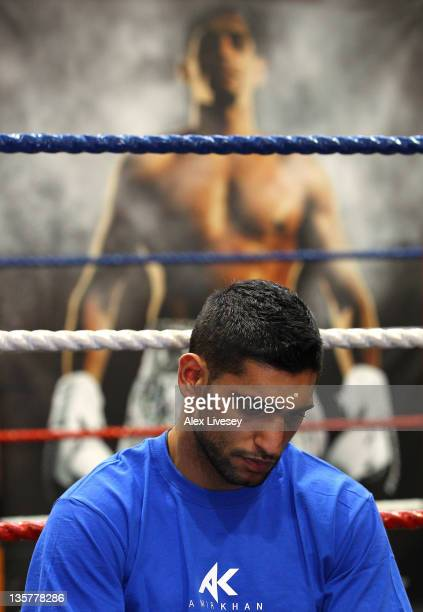 Amir Khan faces the media during a press conference to reflect on his defeat by Lamont Peterson to lose his WBA and IBF lightwelterweight titles at...