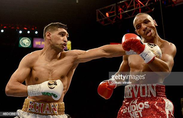 Amir Khan hits Devon Alexander during their welterweight bout at the MGM Grand Garden Arena on December 13 2014 in Las Vegas Nevada Khan won with a...