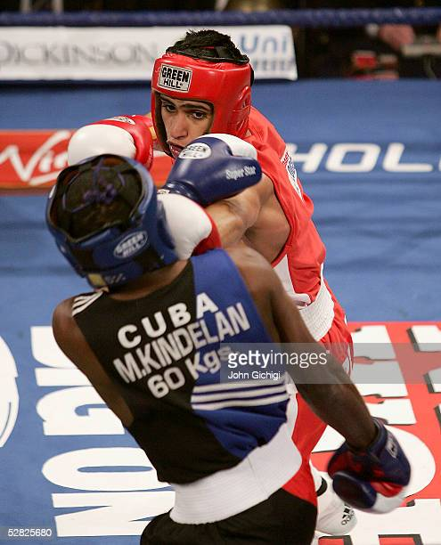 Amir Khan in action against Mario Kindelan during an international contest between England and Cuba at the Reebok Stadium on May 14, 2005 in Bolton,...