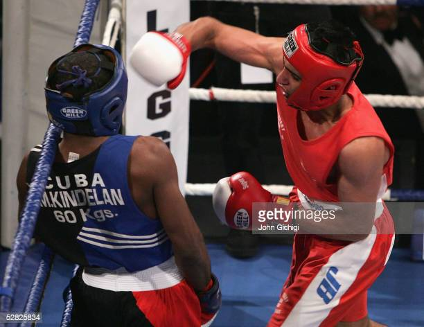 Amir Khan is seen in action against Mario Kindelan during an international contest between England and Cuba at the Reebok Stadium on May 14, 2005 in...