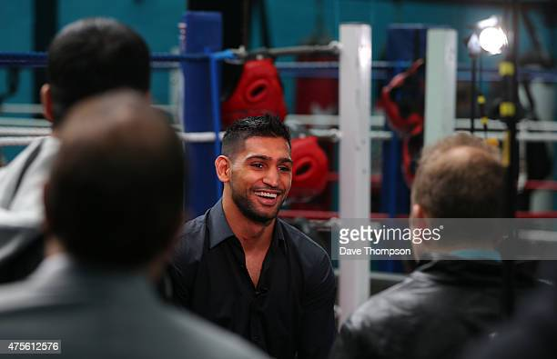 Amir Khan laughs during a television interview during a media day at The Amir Khan Academy on June 2 2015 in Bolton England
