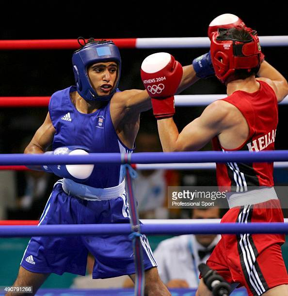 Amir Khan of Britain competes against Marios Kaperonis of Greece during the men's boxing 60 kg preliminary bout on August 16 2004 during the Athens...