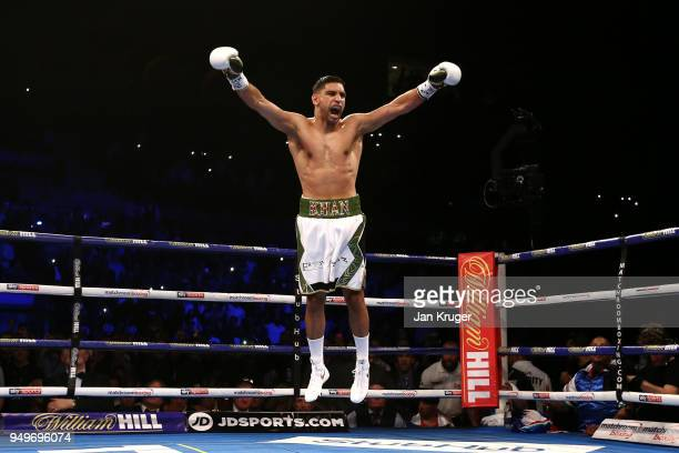 Amir Khan of England celebrates after winning his Super Welterweight bout against Phil Lo Greco of Italy at Echo Arena on April 21 2018 in Liverpool...