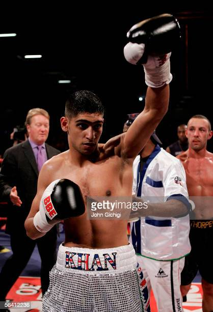 Amir Khan of England celebrates his victory against Daniel Thorpe of England during the International Lightweight fight at the ExCel Centre on...