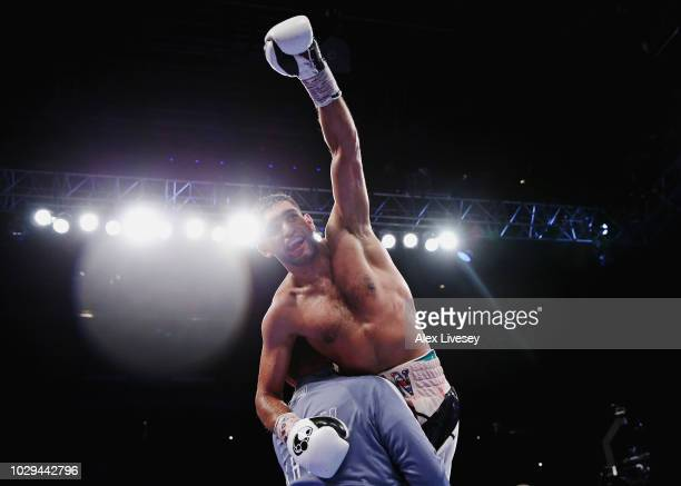 Amir Khan of England celebrates victory over Samuel Vargas of Canada during their Welterweight bout held at Arena Birmingham on September 8 2018 in...
