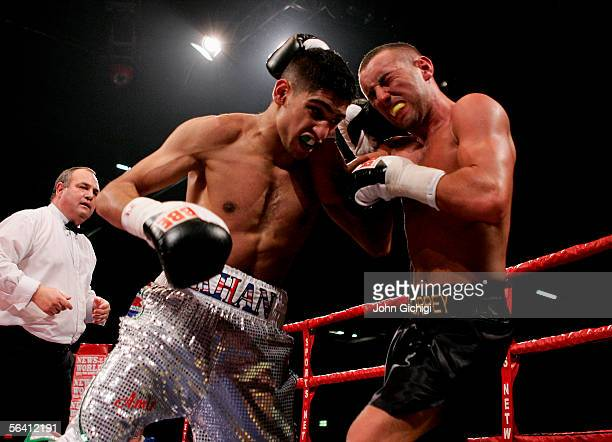 Amir Khan of England in action against Daniel Thorpe of England during the International Lightweight fight at the ExCel Centre on December 10 2005 in...