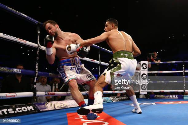Amir Khan of England knocks out Phil Lo Greco of Italy during their Super Welterweight bout at Echo Arena on April 21 2018 in Liverpool England