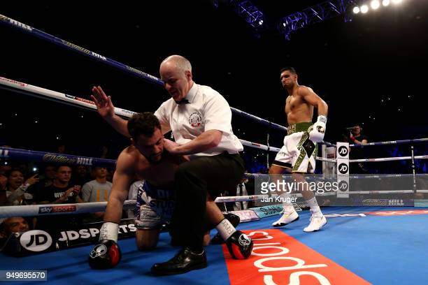 Amir Khan of England looks on as he knocks out Phil Lo Greco of Italy during their Super Welterweight bout at Echo Arena on April 21 2018 in...