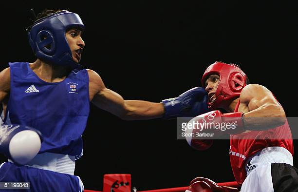 Amir Khan of Great Britain and Dimitar Stilianov of Bulgaria in action during the men's boxing 60 kg preliminary bout on August 20 2004 during the...