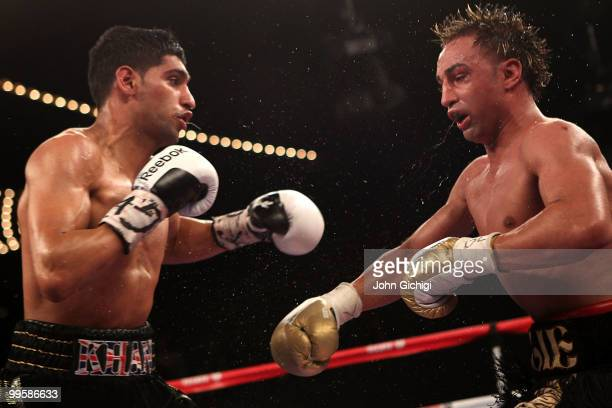 Amir Khan of Great Britain and Paulie Malignaggi exchange blows during the WBA light welterweight title fight at Madison Square Garden on May 15,...