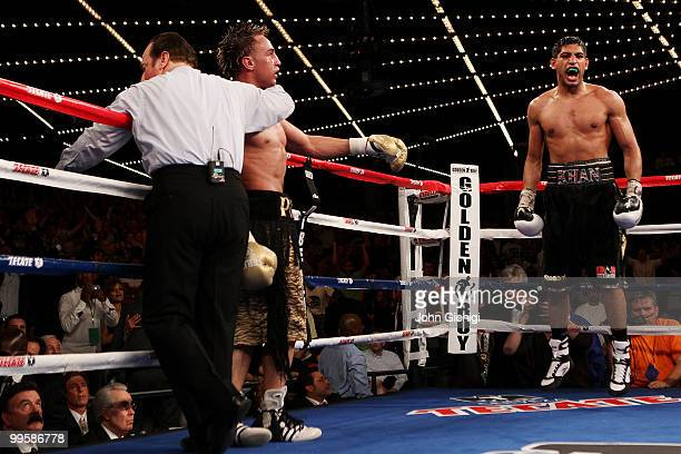 Amir Khan of Great Britain celebrates after defeating Paulie Malignaggi by TKO in the 11th round of their WBA light welterweight title fight at...
