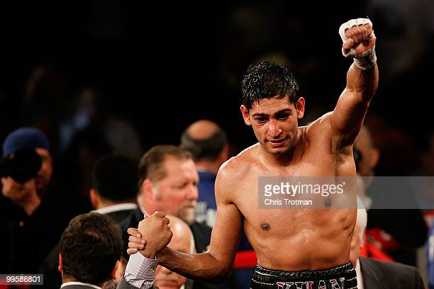 Amir Khan of Great Britain celebrates after defeating Paulie Malignaggi by TKO in the 11th round of his WBA light welterweight title fight at Madison...