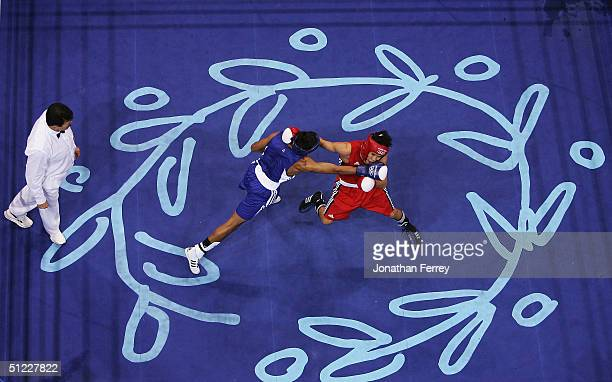 Amir Khan of Great Britain connects on a right against Serik Yeleuov of Kazakhstan during the men's boxing 60 kg semifinal bout on August 27 2004...