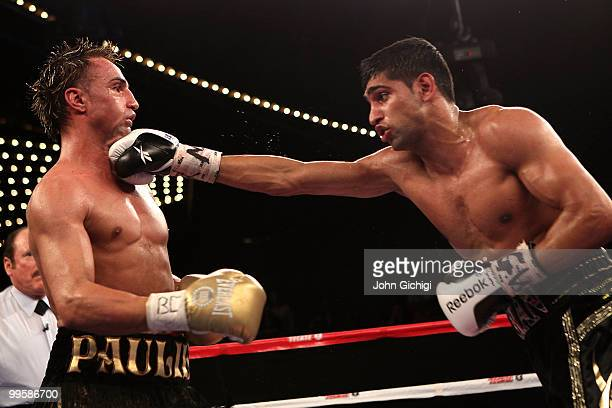 Amir Khan of Great Britain hits Paulie Malignaggi during the WBA light welterweight title fight at Madison Square Garden on May 15, 2010 in New York...