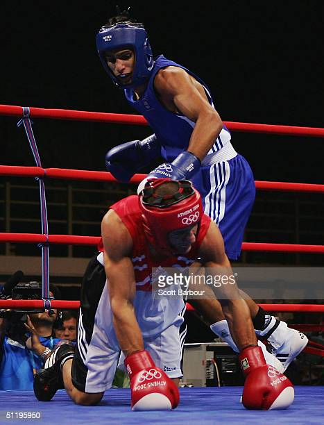 Amir Khan of Great Britain stands over Dimitar Stilianov of Bulgaria during the men's boxing 60 kg preliminary bout on August 20 2004 during the...