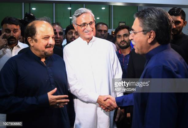 Amir Khan , of the Pakistani Muttahida Qaumi Movement party greets Jahangir tareen , the senior leader of Pakistan Tehreek-e-Insaf party of Imran...