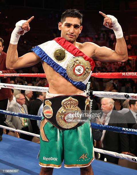 Amir Khan poses after his fifth round knockout of Zab Judah in their super lightweight world championship unification bout at Mandalay Bay Events...