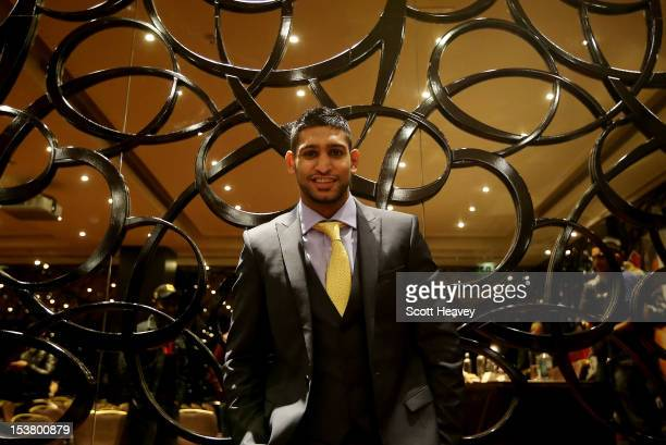 Amir Khan poses during his press conference to announce his upcoming fight with Carlos Molina on October 9 2012 in London England