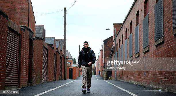 Amir Khan poses on a Bolton street during a photo shoot on April 22 2013 in Bolton England