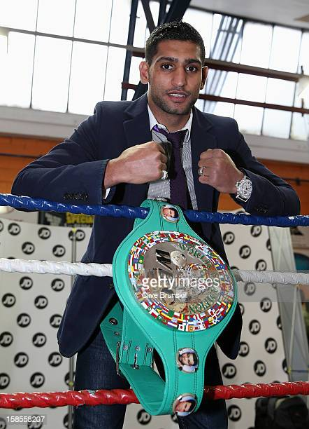 Amir Khan poses with his WBC Silver superlightweight belt in the ring during a media day at the at the Gloves Community Centre on December 19 2012 in...