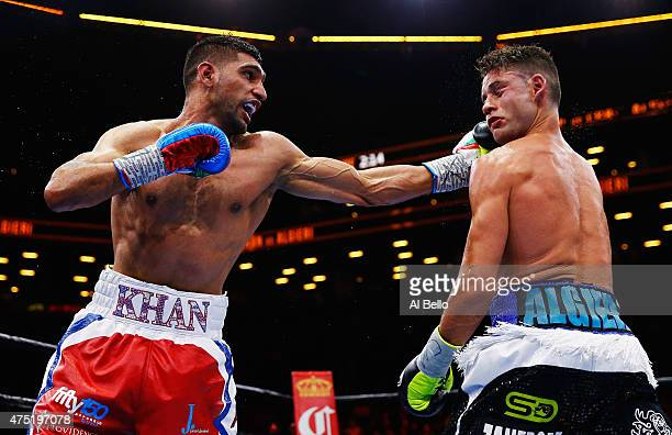 Amir Khan punches Chris Algieri during their Welterweight bout at Barclays Center of Brooklyn on May 29 2015 in New York City