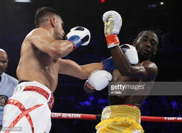 Amir Khan punches Terence Crawford during their WBO welterweight title fight at Madison Square Garden on April 20 2019 in New York City