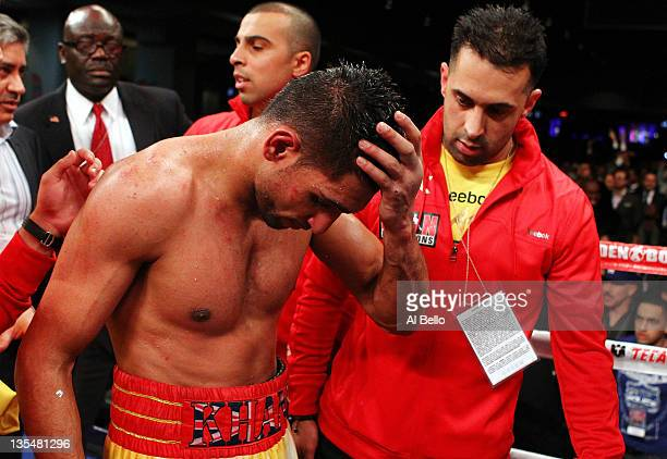 Amir Khan reacts after losing against Lamont Peterson during the Capital Showdown Khan v Peterson WBA/IBF World lightwelterweight title bout at...