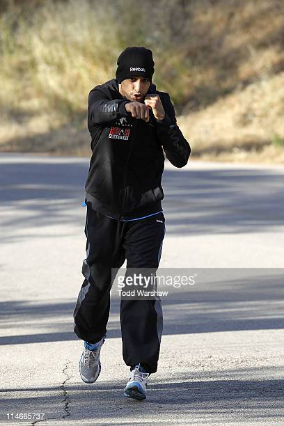 Amir Khan runs in the Hollywood Hills wearing Reebok ZigTech apparel and footwear at Griffith Park on May 25 2011 in Los Angeles California The...