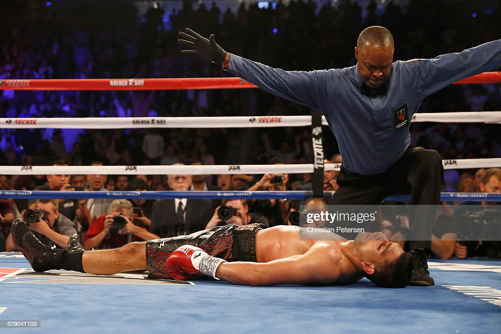 Amir Khan stays down after a knockout from Canelo Alvarez during the WBC middleweight title fight at T-Mobile Arena on May 7, 2016 in Las Vegas, Nevada.