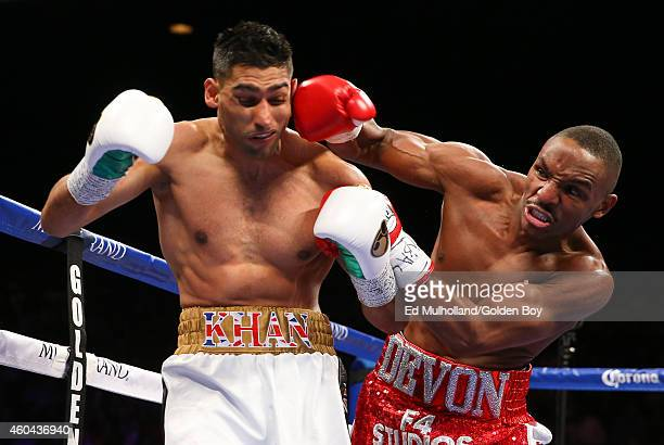 Amir Khan takes a right hand from Devon Alexander during their welterweight bout at the MGM Grand Garden Arena on December 13 2014 in Las Vegas Nevada