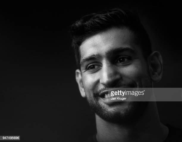 Amir Khan talks to the media during a Press Conference ahead of his fight with Phil Lo Greco at the Hilton Hotel on April 17 2018 in Liverpool England