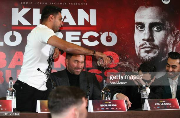 Amir Khan throws a glass of water over Phil Lo Greco during an Amir Khan and Phil Lo Greco press conference at the Hilton Hotel on January 30 2018 in...