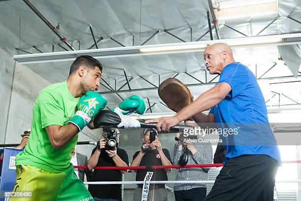 Amir Khan works the mitts with trainer Virgil Hunter during an open media workout on April 18 2016 in Hayward California