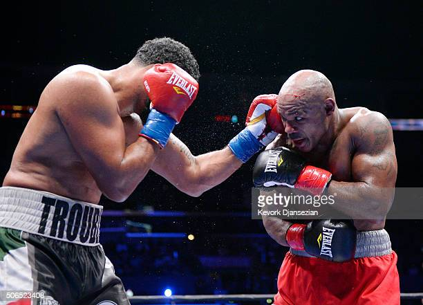 Amir Mansour ducks a punch from Dominic Breazeale during the heavyweight bout at Staples Center January 23 2016 in Los Angeles California Breazeale...
