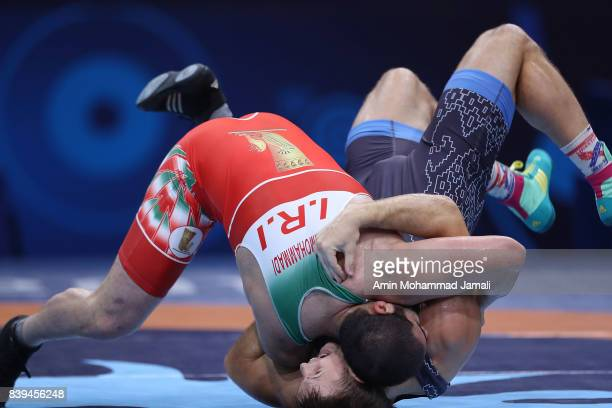 Amir Mohsen Mohammadi of Iran in action against Aliaksandr Hushtyn of Belarus during World Wrestling Championships in qualification freestyle Seniors...