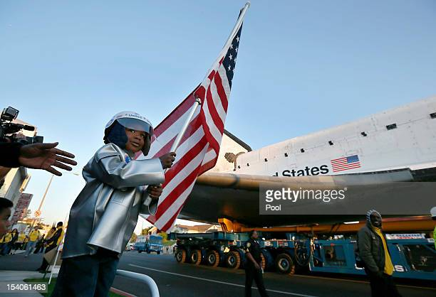 Amir Morris watches the Space Shuttle Endeavour being moved to the California Science Center on October 13 2012 in Inglewood California The space...