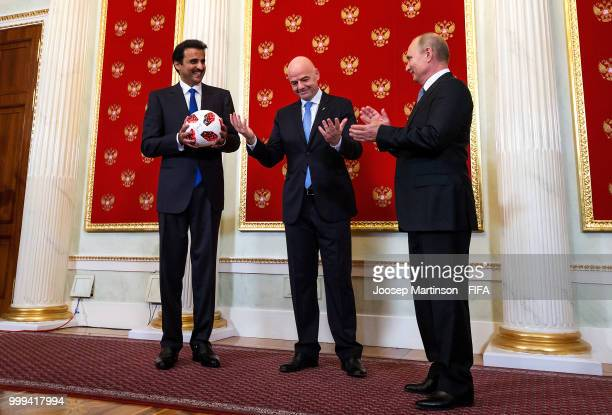Amir of Qatar Sheikh Tamim bin Hamad Al Thani, FIFA president Gianni Infantino and President of Russia Valdimir Putin participate in a handover...