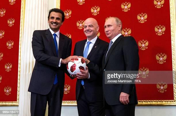 Amir of Qatar Sheikh Tamim bin Hamad Al Thani, FIFA president Gianni Infantino and President of Russia Valdimir Putin participate in a handover...