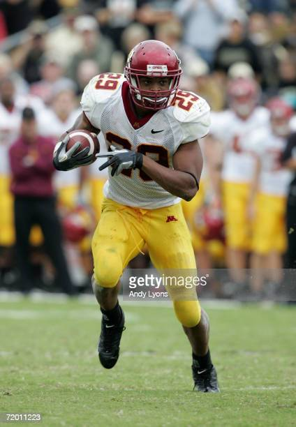 Amir Pinnix of the Minnesota Golden Gophers runs with the ball against the Purdue Boilermakers during a Big Ten Conference game September 23 2006 at...