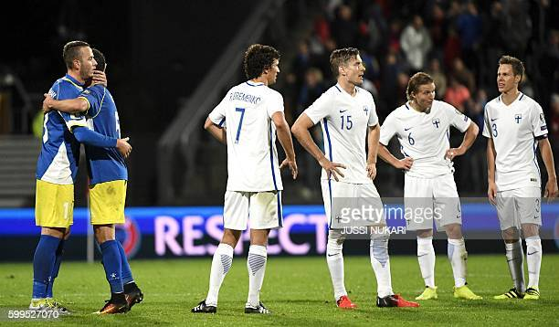 Amir Rrahmani and Enis Alushi of Kosovo celebrate while Roman Eremenko Markus Halsti Aleksander Ring and Niklas Moisander of Finland react at the end...