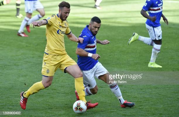 Amir Rrahmani of Hellas Verona and Fabio Quagliarella of UC Sampdoria battle for the ball during the Serie A match between UC Sampdoria and Hellas...