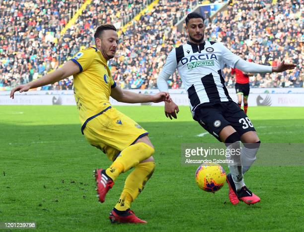 Amir Rrahmani of Hellas Verona competes for the ball with Rolando Mandragora of Udinese Calcio during the Serie A match between Udinese Calcio and...