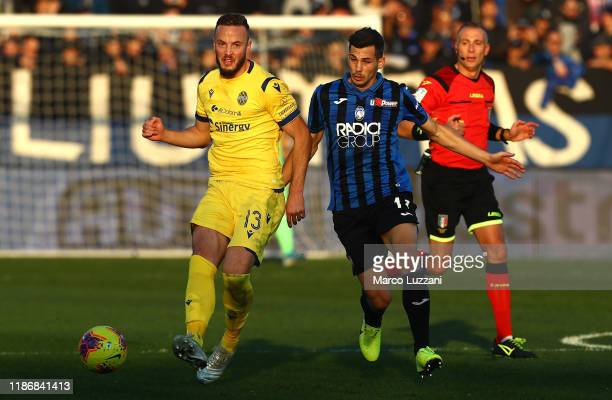 Amir Rrahmani of Hellas Verona is challenged by Remo Freuler of Atalanta BC during the Serie A match between Atalanta BC and Hellas Verona at Gewiss...