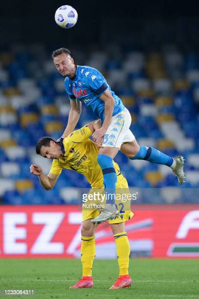 Amir Rrahmani of SSC Napoli and Kevin Lasagna of Hellas Verona jump for the ball during the Serie A match between SSC Napoli and Hellas Verona at...