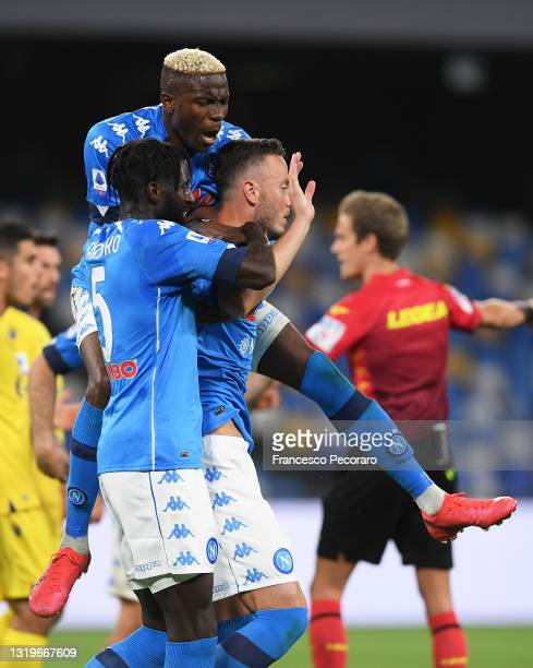 Amir Rrahmani of SSC Napoli celebrates with team mates Tiemoue Bakayoko and Victor Osimhen after scoring his team's first goal during the Serie A...